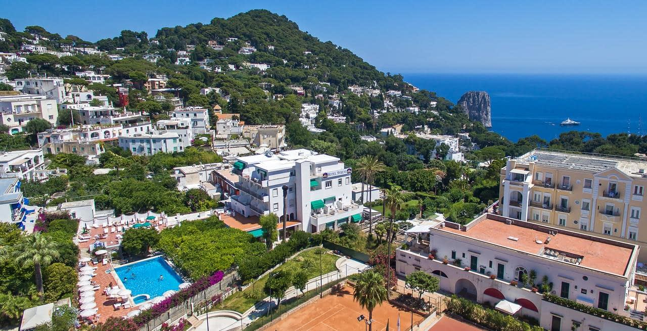 Hotel Syrene in Capri on the left of photo with swiming pool