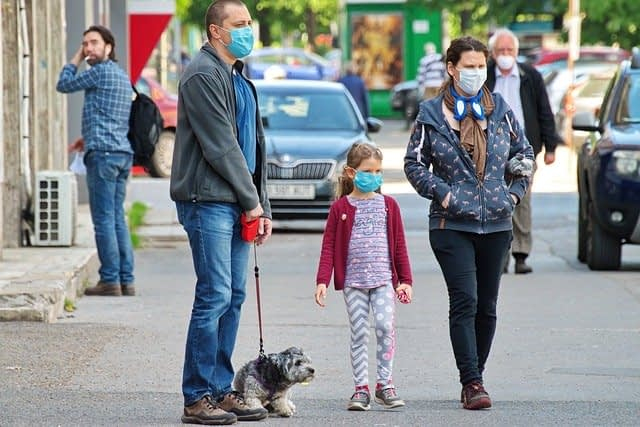 People Wearing Coronavirus Masks with Dog