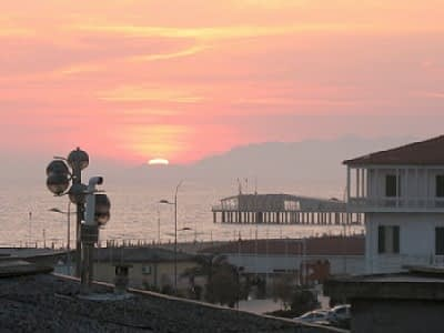 View of sunset on the beach from the terrace of a Viareggio apartment